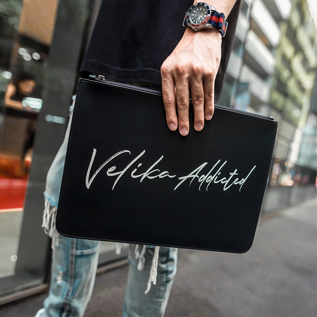 VELIKA ADDICTED SCRIPT CLUTCH BAG
